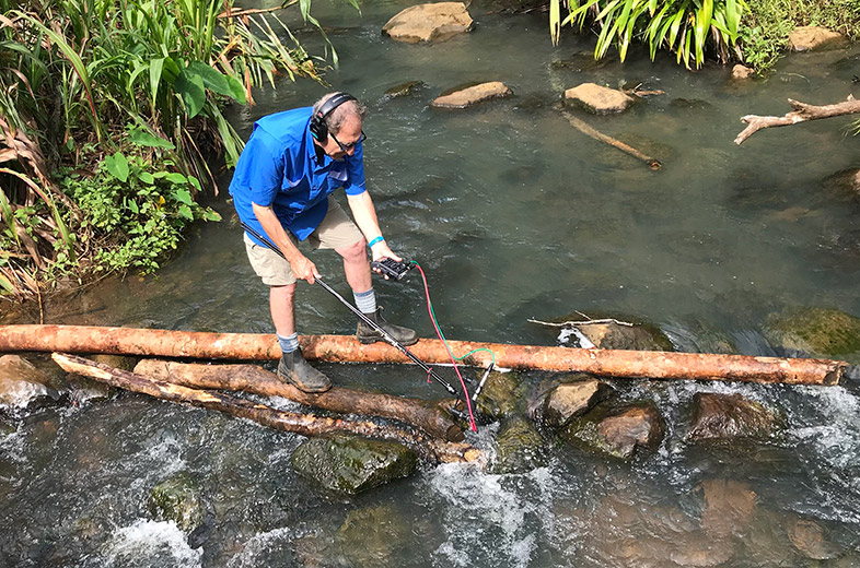 Steven Feld records water sound effects at Wolo Creek, Bona Village, Bosavi, 2018